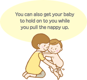 You can also get baby to hold on to you while you pull the diaper up.