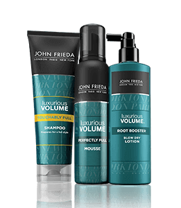 Three products from John Frieda's Luxurious Volume range (shampoo, mousse and blow dry lotion)